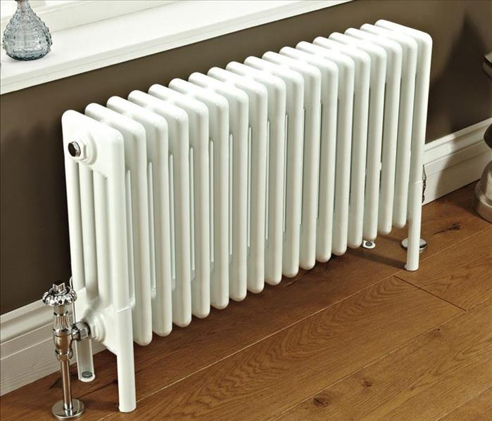 Radiator next to window